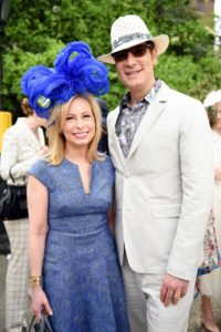 Philanthropists, Gillian Miniter, and Cameron Silver in their festive hats. (Photo courtesy of BFA.com)