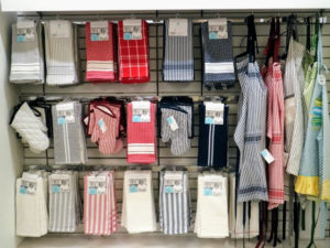 This rack contains some of our individual kitchen tea towels and oven mitts.
