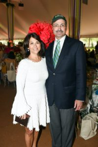 This is CEO of J.P. Morgan's U.S. Private Bank, Kelly Coffey, wearing a red floral hat, and Central Park Conservancy President and CEO Douglas Blonsky, in a baseball cap. Kelly served as the Corporate Honoree for the financial institution. (Photo courtesy of BFA.com)