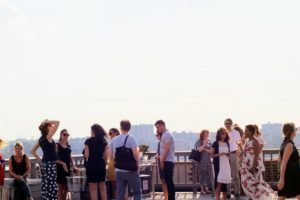 The event was held on our rooftop deck at the historic Starrett-Lehigh Building. Our executive offices look out over the Hudson River. It was a warm and windy evening, but a beautiful venue for the gathering. (Photo by Laura Manzano)