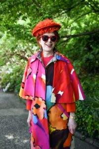 This is Mary Wallach in a colorful outfit and hat. (Photo courtesy of BFA.com)