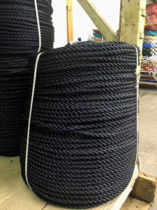 Each mat is constructed from custom made polypropylene cordage. This is a coil of the black rope that was used to make my doormats for the farm. (Photo by Dawn Stahl)
