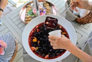 My longtime housekeeper, Laura, set up some refreshments on the lower terrace parterre outside my kitchen. Here she is pouring some cool pomegranate juice made using concentrate from our friends at http://www.pomwonderful.com/