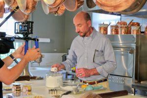 Robert combines the ingredients for the fondant. If you missed the process for this, be sure to go to our Facebook page and watch the show.