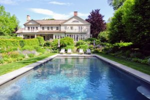 Here is a view of the home from the far end of the pool. The new pool at my Bedford, New York farm, was inspired by this pool.