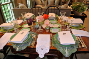My housekeeper, Laura, always sets a beautiful table - and the flowers I added look great with the green and white tablescape.