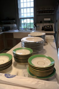 The plates are all ready to go - they were collected from the table and stacked on the kitchen counter.