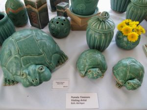 These are by Pamela Timmons, a visiting artist from Bath, Michigan. She is a well-established potter and sculptor, who started as a horticulturalist, ran out of vases and turned to clay to make more.