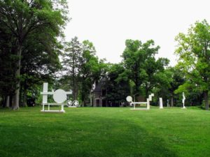 In this field, from left to right, all the works are by David Smith. 'Primo Piano III', 1962; '2 Circles 2 Crows', 1963; 'Primo Piano II', 1962; 'Untitled', 1963; 'Cubi XXI', 1964; and 'Circle and Box (Circle and Ray)', 1963. Storm King has one of the most significant institutional holdings of David Smith's works.