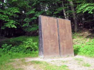 This is by Mia Westerlund Roosen, 'Muro Series X', 1979. It was commissioned by and created at Storm King as part of a series of the artist's wall-like pieces from the 1970s. This was made by pouring concrete to form thin horizontal slabs that when stood up become monolithic vertical surfaces.