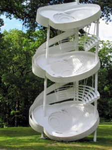 "This is by Alice Aycock, 'Three-Fold Manifestation II', 1987 (refabricated 2006). The artist describes it as ""three bowls or whirling, skewed spaces that are tipped, so it's as though you're looking into disoriented worlds."""