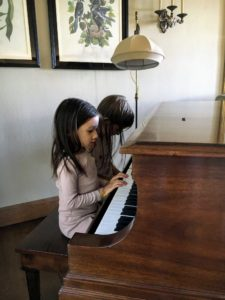 "In the house, Quinn and Jude were playing the piano. Quinn said she was playing song she made up - Quinn is four. Jude, who is now six, also explained Beethoven and Mozart to Quinn during their ""duet"". (Photo by Kate Berry)"