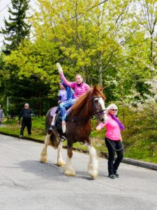There was one beautiful draft horse in the parade. A draft horse, draught horse or dray horse, is a large horse bred for hard tasks such as plowing and other farm labor. Its young riders were so proud to ride through Main Street on their handsome steed.