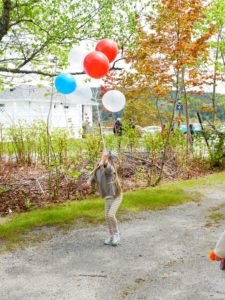 Jude had so much fun carrying her red, white and blue balloons. She's grown so much this year.