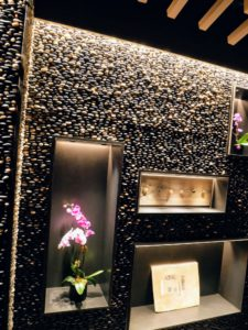 At the bottom, guests are greeted by a river rock wall - a special nod to Nobu's original TriBeCa flagship location - these stones were actually moved from the old Nobu to this one.