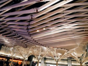 I admired the dining room's ceiling filled with blond-wood slats inspired by the Japanese origami called kirigami, which utilizes paper cutting in addition to paper folding.