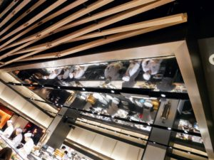 Nobu wanted to keep the kitchen area full of light, so they topped the kitchen ceiling with mirror.
