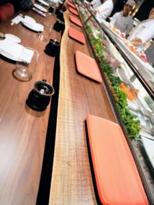 At the far end of the main dining room is a 13-seat sushi bar located in front of an open kitchen where guests can watch the master sushi chefs at work.