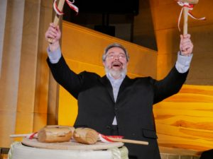 And here is restaurateur and co-owner, Drew Neiporent, holding up the mallets that are used to crack open the drum filled with sake.