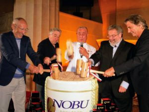 And then all the owners—Nobu, Robert, Meir, and Drew, along with David, cracked open the drum.