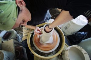 And this artist is wheel throwing a classic vase. (Photo by Cybelle)