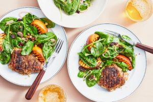 This is Berkshire Pork Tenderloin with Cherry-Peach Spinach Salad. The tender, sweet peaches are tossed with a tart cherry-shallot-spinach salad and served alongside boldly-spiced Berkshire pork tenderloin steaks. (Photo by Linda Pugliese)