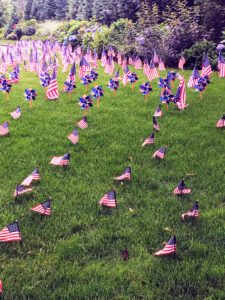 Claire also captured this photo of a neighborhood lawn covered with tons of small American flags and pinwheels. She said this family usually goes all out with lawn decor every holiday.