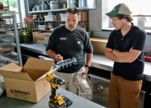 Adam Lemieux, Johnny's Tools and Supplies Product Manager, goes over the new items with Ryan.