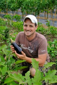 We also harvested several eggplants. I like to pick them when they're smaller. Here's Ryan with one that is the perfect size.
