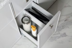 All of the vanity drawers are built with more than enough storage space. This pull-out drawer is tall enough to store bottles, jars, and tubes - and all your supplies can be stored standing up.