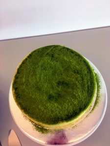 This lovely green tea mille crepé cake is decorated with matcha, a ground powder of specially grown and processed green tea. Green tea powder is also infused into each of the mille crêpes that make up this dessert - so pretty.