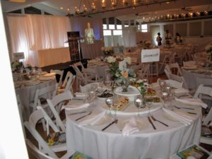 The venue was decorated in crisp white with delicate light colored summer blooms on each table.