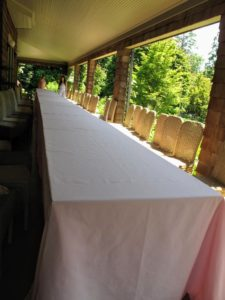 For this party, I wanted everyone to sit at one long table, so we put six eight-foot long tables together surrounded by 55 wicker chairs. I always have many, many chairs for entertaining.