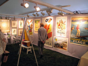 The walls of this tent are filled with antique and vintage prints.