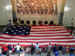All the volunteers sang the National Anthem at the museum.