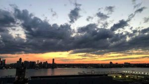Emily Morse, also our executive administration intern, spent the Fourth with friends in New York City. This photo was taken from the rooftop of the Hugo Hotel - it was a lovely sunset over the Hudson River.
