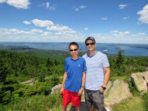 Here are Rock and Nicholas on top of Cadillac Mountain. The Porcupine Islands can be seen behind them.