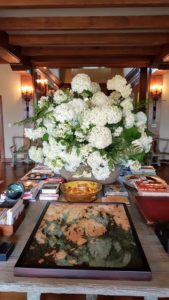 The Living Hall at Skylands is always used during summer months. This grand faux-bois cement table, made by artist Carlos Cortes, is where I like to display large flower arrangements for my parties.