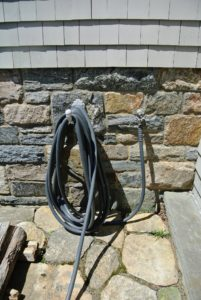 Here is a hose across from the carport, not far from the basement door to my Winter House.