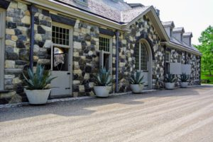 Everyone loves visiting the stable at my Bedford, New York farm. It is located at one end of my long Boxwood Allee.
