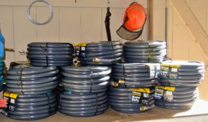 The Gilmour 100-foot Flexogen hose is a heavy-duty eight-ply garden hose with a polished surface that resists abrasions, stains, and mildew. I have these hoses all over the farm.