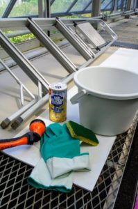Here are the main supplies we are using - gloves, sponges, ladders, water and Barkeeper's Friend, a great product containing oxalic acid. The abrasive used in this powder doesn't scratch glass or porcelain when properly used, so it works well on windows.