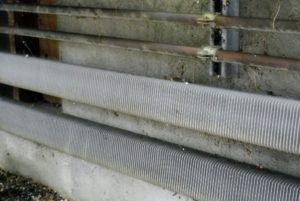 Dust and debris can also accumulate underneath the long sliding tables.