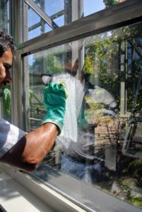 On this window, Carlos notices some of the calcium remained on the glass after he cleaned it.