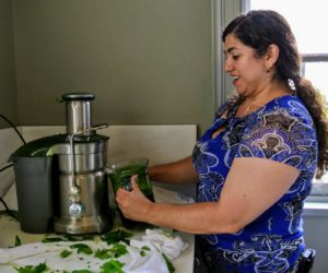 Once all the New Zealand spinach was picked, Enma ran it through the juicer, so it could be saved in tubs and frozen for later use.