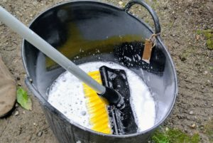 Fernando also dilutes a small amount of dishwashing detergent in a big trug bucket of water.