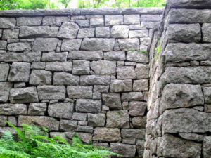 Here is one of the many beautiful stone retaining walls around the property.