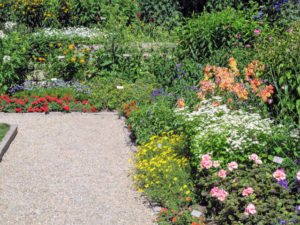 The Garden was designed as a classic English garden bed, with a rectangular shape, and surrounded by pink granite pebble paths.