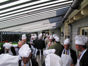 It is a tradition for members to wear hats and aprons.