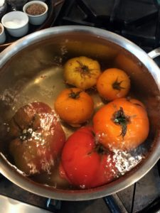 While I boil another batch in this big pot - these are yellow and orange tomatoes. This method is very helpful when working with another person, so one can poach the tomatoes while the second person peels them.